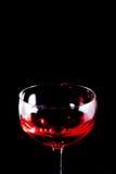 Vidrio del aislante del negro del vino rojo Imágenes de archivo libres de regalías