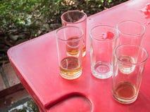 Vidrio del alcohol cuando extremo del partido Foto de archivo libre de regalías