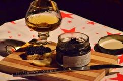 Vidrio del aperitivo del brandy y del caviar Fotografía de archivo libre de regalías