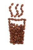Vidrio del café de los granos de café Foto de archivo libre de regalías