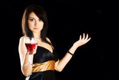 Vidrio del ingenio de la mujer de vino. Foto de archivo libre de regalías