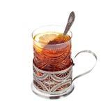 Vidrio del té con un limón en un vidrio-tenedor Fotos de archivo libres de regalías