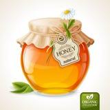 Vidrio del tarro de la miel Fotos de archivo libres de regalías