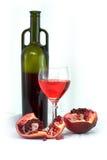 Vidrio del vino, de la botella y de una granada roja Fotografía de archivo libre de regalías