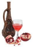 Vidrio del vino, de la botella y de una granada roja Fotos de archivo libres de regalías