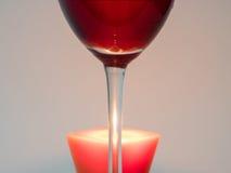 Vidrio del vino y de una vela Imagen de archivo