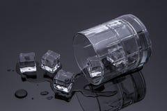 Vidrio derramado con hielo Imágenes de archivo libres de regalías