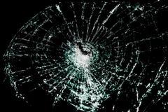 Vidrio quebrado en un fondo negro Foto de archivo