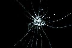 Vidrio quebrado en un fondo negro Fotografía de archivo