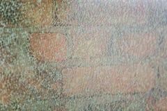 Vidrio quebrado sobre macro de la pared de ladrillo fotografía de archivo