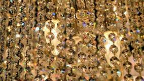 Vidrio transparente de oro de lujo en el viento, almacen de video
