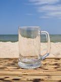 Vidrio vacío en una playa Imágenes de archivo libres de regalías
