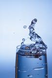 Vidrio y agua Imagen de archivo libre de regalías