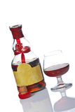 Vidrio y botella de brandy imagen de archivo