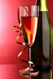 Vidrio y botella de champán Imagenes de archivo