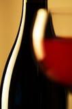 Vidrio y botella de vino Imágenes de archivo libres de regalías