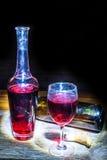 Vidrio y botella de vino Imagenes de archivo