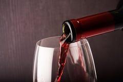 Vidrio y botella de vino Foto de archivo libre de regalías