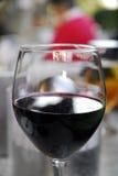 Vidrio y lápiz labial de vino Imagen de archivo libre de regalías