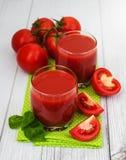 Vidrios con el jugo de tomate Foto de archivo libre de regalías