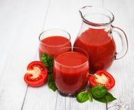 Vidrios con el jugo de tomate Imágenes de archivo libres de regalías
