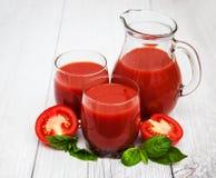 Vidrios con el jugo de tomate Fotos de archivo libres de regalías