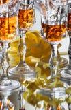 Vidrios con el licor fuerte Imágenes de archivo libres de regalías