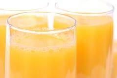 Vidrios con el zumo de naranja Fotos de archivo libres de regalías