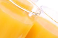 Vidrios con el zumo de naranja Fotos de archivo