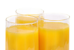 Vidrios con el zumo de naranja Foto de archivo