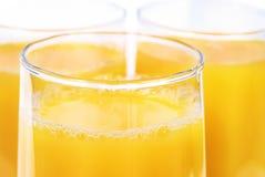 Vidrios con el zumo de naranja Imagen de archivo