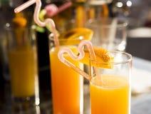 Vidrios con el zumo de naranja Fotografía de archivo libre de regalías