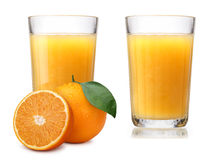 Vidrios con el zumo de naranja fresco Imagen de archivo libre de regalías
