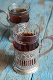 Vidrios con té negro Imágenes de archivo libres de regalías