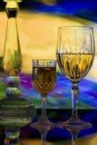 Vidrios cristalinos y palmatoria Fotos de archivo