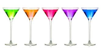 Vidrios de cóctel provenidos Sistema colorido de licores exóticos Imágenes de archivo libres de regalías