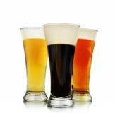 Vidrios de cerveza del alcohol en blanco Imagen de archivo libre de regalías