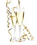 Vidrios de champán con la cinta del oro Fotos de archivo
