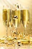 Vidrios de champán de oro Fotografía de archivo libre de regalías