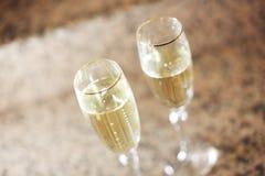 Vidrios de champán en la tabla Imagen de archivo libre de regalías