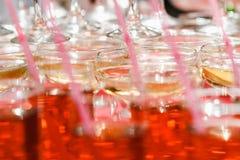 Vidrios de champán en la tabla Foto de archivo libre de regalías