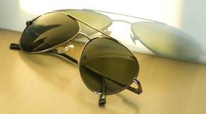 Vidrios de sol viejos. Fotos de archivo
