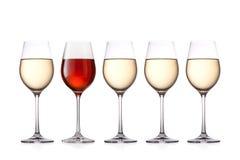 Vidrios de vino aislados en el fondo blanco Fotografía de archivo libre de regalías