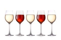 Vidrios de vino aislados en el fondo blanco Imagen de archivo libre de regalías