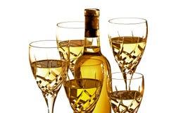Vidrios de vino blanco con la botella Imagen de archivo