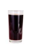 Vidrios de zumo de fruta rojo en blanco Imágenes de archivo libres de regalías
