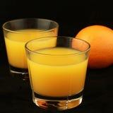 Vidrios de zumo de naranja Fotografía de archivo