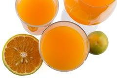 Vidrios de zumo de naranja Imágenes de archivo libres de regalías