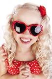Vidrios del corazón de la muchacha que desgastan divertida Foto de archivo libre de regalías
