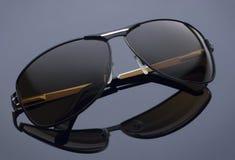 Vidrios elegantes del ojo aislados en el fondo gris Fotografía de archivo libre de regalías